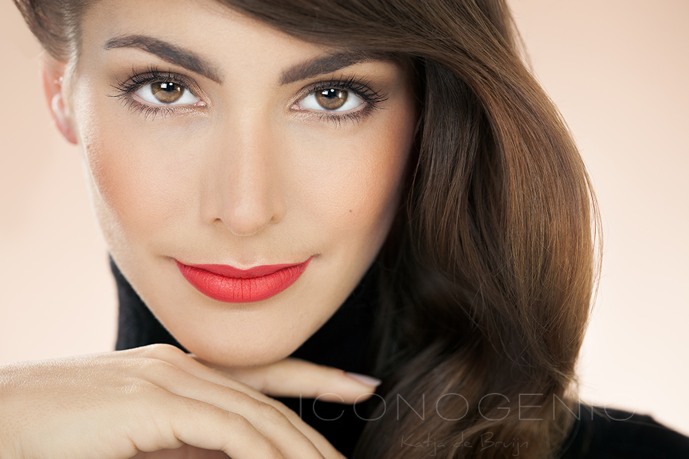 Beautiful model with matte red lipstick. Fashion and beauty concept in studio.